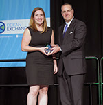 Samantha Lindgren of Sun Buckets accepts the 2016 Navigator Award from Ira Berman of Gulfstream®.
